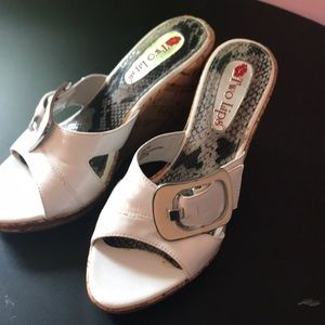 White strap with buckle and faux cork heel